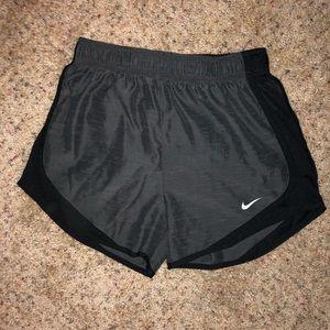 Black and grey Nike shorts.